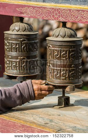 Manang, Nepal - May 5, 2016: Buddhist prayer mani wall with prayer wheels in nepalese village on the Annapurna circuit trekking route, Nepal