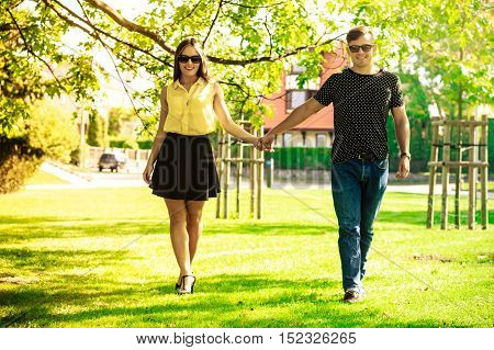 Couple Holding Hands In Park.