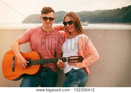 Happy Couple With Guitar Outdoor
