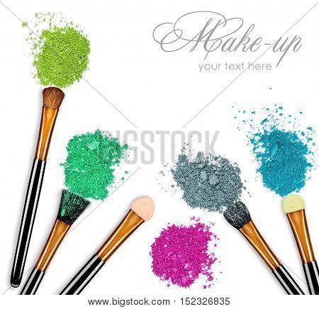 set of various eyeshadows and make-up brushes on white background