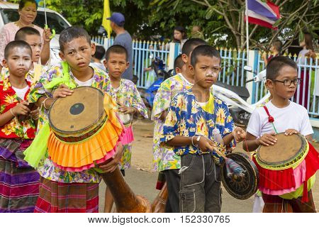 SISAKETTHAILAND. On October 1 2016 in rural northeastern province of Sisaket Boy play and dancing in traditional Sart Thai. SART THAI is an important tradition of rural Thailand.