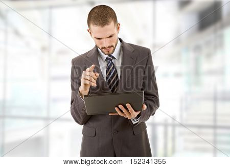 businessman using touch pad of tablet pc, at the office