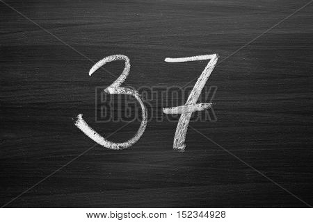 number thirty seven enumeration written with a chalk on the blackboard