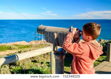 Kid watching whales at Port Elliot South Australia
