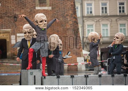 KRAKOW, POLAND - SEP 17, 2016: Participants of Krakow Theatre Night festival -KTO Teatre (Peregrinus, written and directed by J.Zon) in Main Market Square. Entry to all shows of Theatre Night is free.