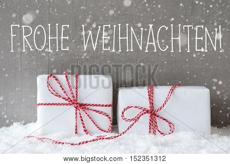 German Text Frohe Weihnachten Means Merry Christmas. Two White Christmas Gifts Or Presents On Snow. Cement Wall As Background With Snowflakes. Modern And Urban Style.