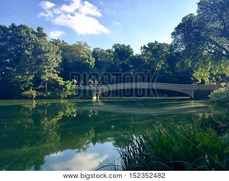 Bow Bridge reflects on the lake in the morning at Central Park, Manhattan, New York