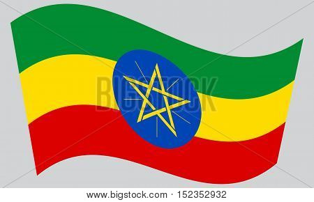 Ethiopian national official flag. African patriotic symbol banner element background. Correct colors. Flag of Ethiopia waving on gray background vector
