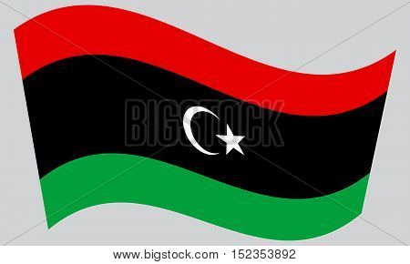 Libyan national official flag. African patriotic symbol banner element background. Correct colors. Flag of Libya waving on gray background vector