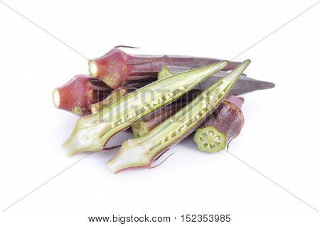 fresh whole and cut red okra on white background