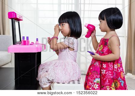 Asian Chinese Liitle Sisters Playing With Make-up Toys
