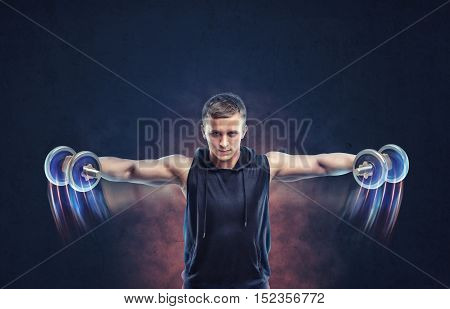 Cropped portrait of a fitness man doing lateral raise with dumbbells. Doing sport exercises. Building muscles. Heavy weights workout.
