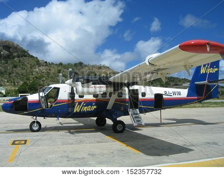 ST. BARTS, FRENCH WEST INDIES - JANUARY 23, 2005: Winair plane on tarmac at St Barts airport. St. Barts is considered a playground of the rich and famous.