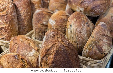 Onion and raisins bread and group of baked goods for sale at farmers market