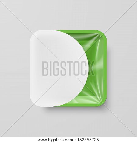 Empty Green Plastic Food Square Container with White Label on Gray