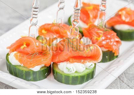 cucumber canape with dill cream cheese and smoked salmon appetizer