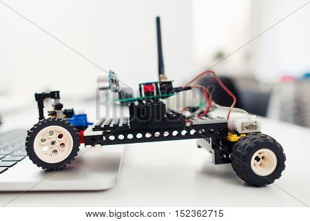 Handmade rc car from children construction, side view. Diy toy, electronics development, hobby concept