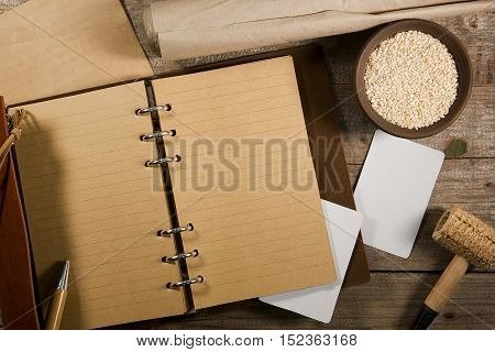 Sesame and book for records on an old wooden table