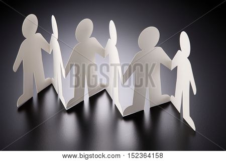 Cut out of paper people in chain