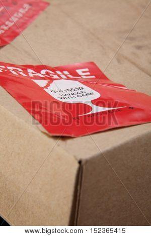 damaged cardboard box with fragile sticker