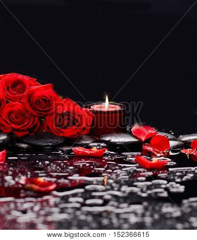 Still life with red rose with red candle and therapy stones