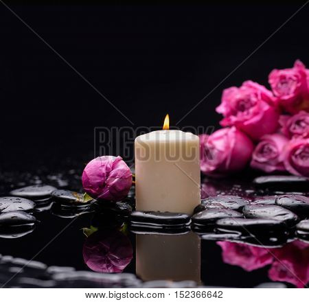 Still life with lying down rose with candle and therapy stones