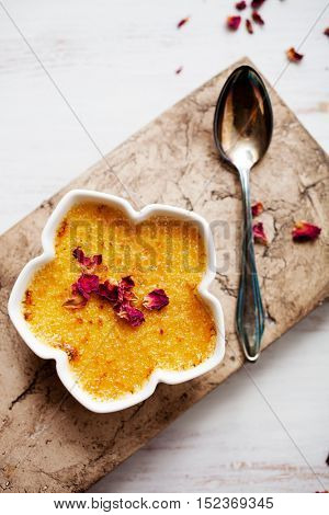 Homemade creme brulee with edible pink roses