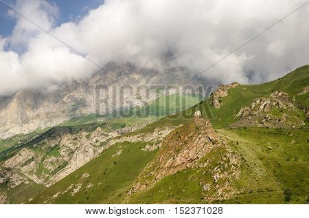 Mountain landscape. Medieval fortress on the top of the mountain in Kabardino - Balkaria Caucasus Russia