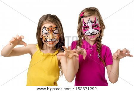 two little girls with colorful painted faces growling like animals isolated on white background