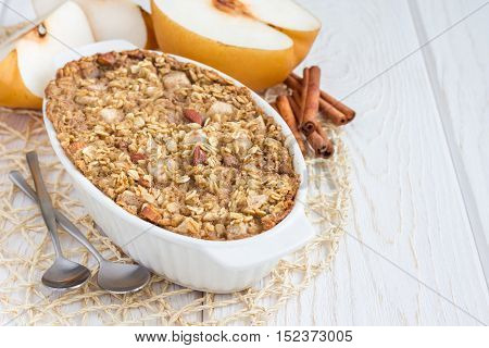 Baked oatmeal with nuts almond milk honey spices and asian pear horizontal copy space