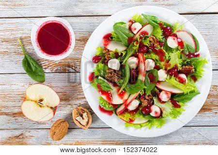 Salad Of Apple, Spinach, Mini Mozzarella Balls, Lettuce Leaves, Walnuts