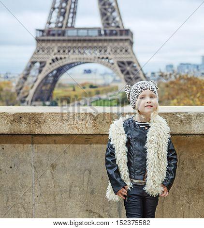 Modern Child Standing Against Eiffel Tower In Paris, France