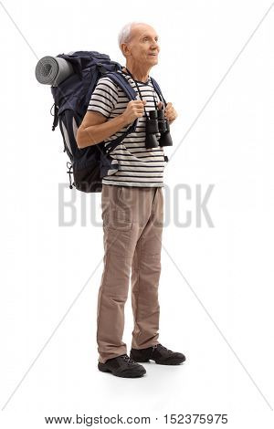 Full length portrait of a senior hiker looking in the distance isolated on white background