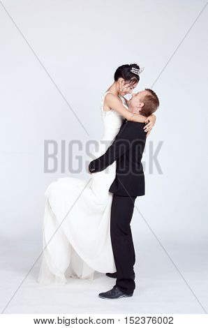Mixed Race Bride and Groom in Studio