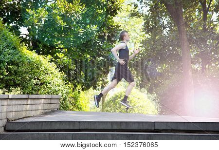 Side view of man running in park