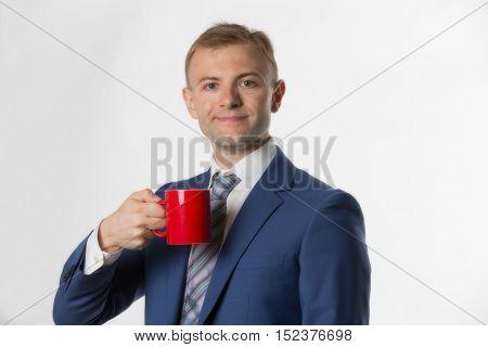 Businessman holding a red mug