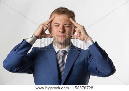 Businessman holding head with a headache