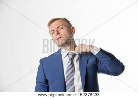 Businessman adjusting his collar as he feels hot