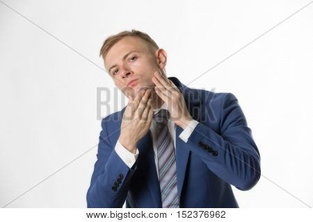 Businessman touching his face highlighting skin care