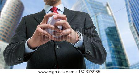 Detail of a businessman crumpling a document