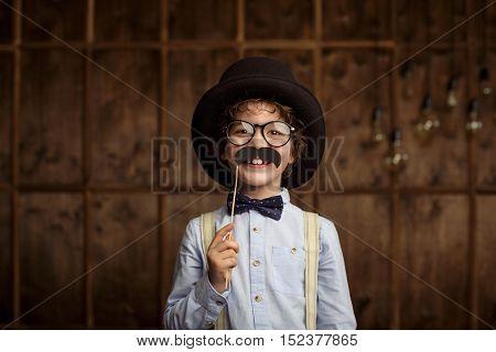 Smiling little boy in studio