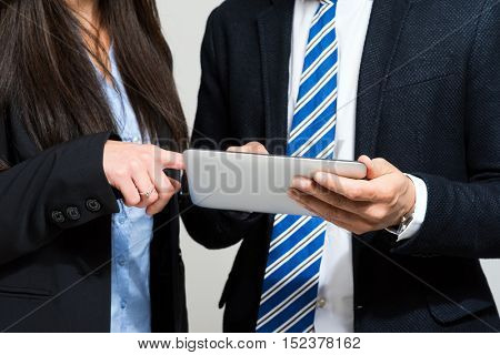Business colleagues using a digital tablet