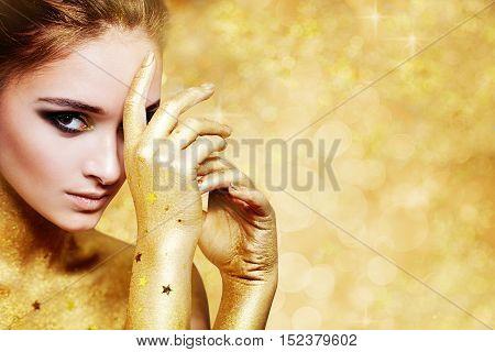Beautiful Woman on light Golden Glitters Background