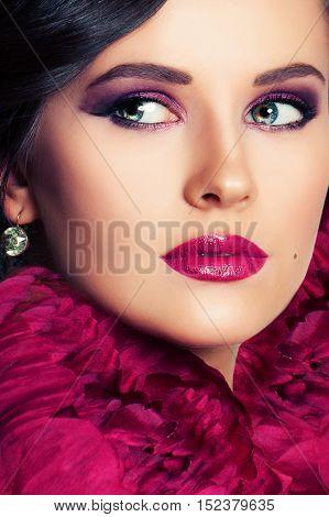 Beautiful Woman with Makeup and Flowers. Face Closeup
