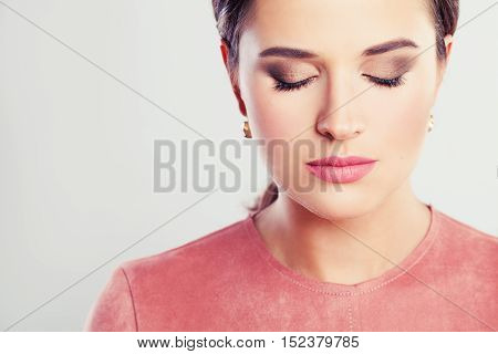 Beautiful Woman Fashion Model with Makeup and Closed Eyes