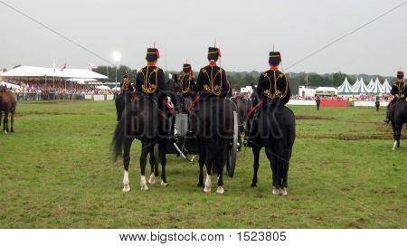 Men In Uniform Riding Horses.