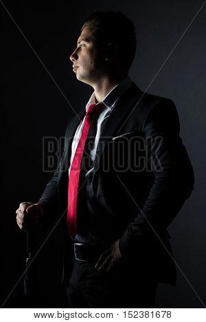 side portrait of elegant proud businessmann in low key shot