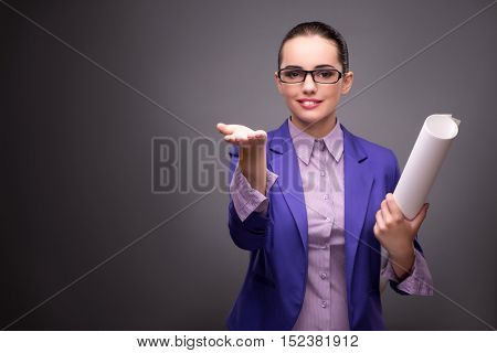 Young woman architect pressing buttons