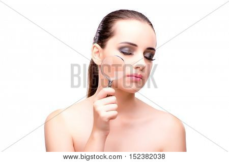 Woman with magnifying glass on white