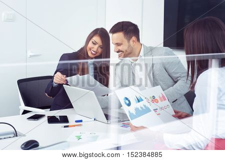 Business partners discussing ideas or project at meeting in office